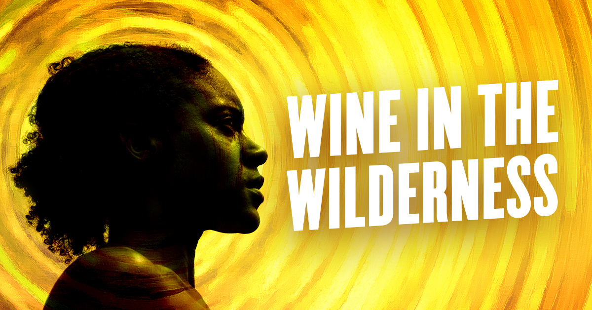 "A graphic featuring a photo of a Black woman's profile next to the words ""Wine in the Wilderness"" with a background of bright yellow and orange paintbrush strokes that emanate out like rays circling the sun."